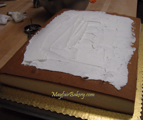 Mayfair Bakery circus tent cake being assembled